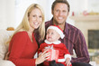Couple With Baby In Santa Outfit