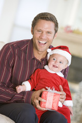 Father With Son In Santa Outfit