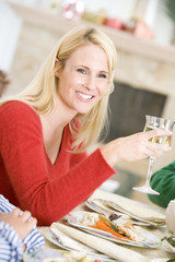 Woman Enjoying Christmas Dinner