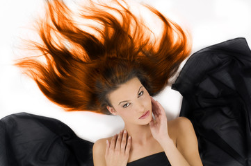 sensual girl laying down with hair in flame on floor and black