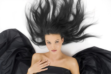 sensual and cute young woman laying down with black hair