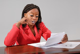 attractive african businesswoman in red poster