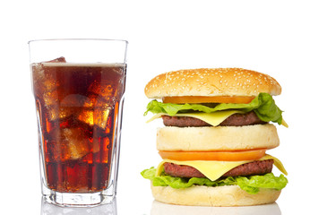 Cheeseburger and soda glass, reflected on white background