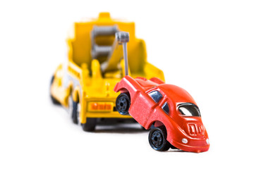 Red car being towed away by yellow tow truck (2)