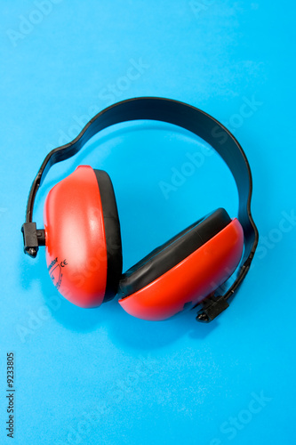 Hearing protection earmuffs on blue background