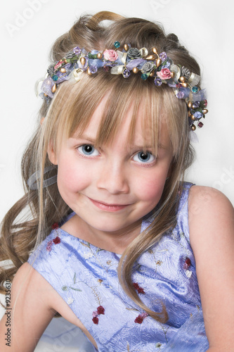 Young girl with a lavender dress and fairywand