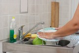 Washing dishes in the kitchen poster