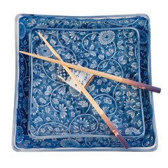 Square Oriental plates with chopsticks