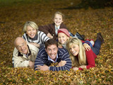 Germany, Baden-Württemberg, Swabiaportrn mountains, Family lying on autumn leaves