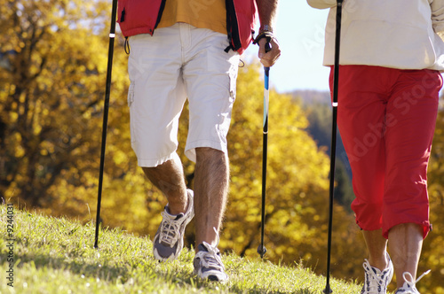 Senior couple Nordic walking, close-up, low section