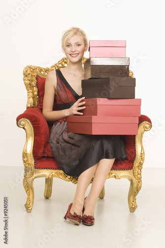 Young woman with stack of shoeboxes, portrait