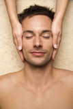 Germany, man receiving facial massage, close-up