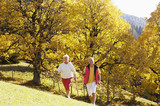 Senior couple Nordic walking outdoors