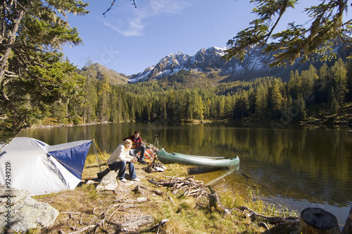 Young couple camping at lake