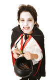 Cute adolescent boy dressed as a vampire for Halloween poster
