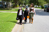 Kids in halloween costumes trick or treating in neighborhood. poster