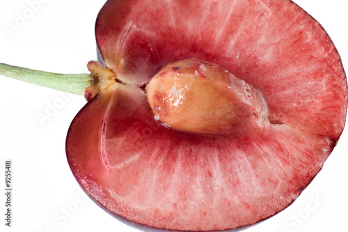 Ripe cherry cut in halves, isolated on white background