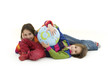 two children embracing the world globe isolated on white