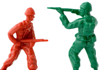 some toy soldiers aiming at each other