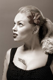 fifties style monochrome portrait of beautiful girl with tattoo poster