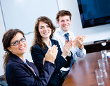 Happy businesspeople clapping on business training poster