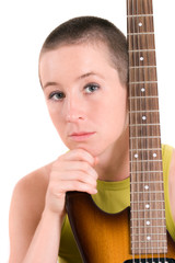 Young woman with electric guitar on the white background
