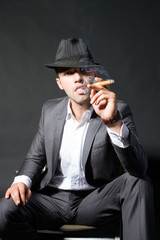 Portrait of the man smoking a cigar