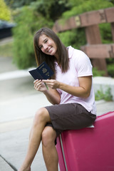 Female traveller with her passport