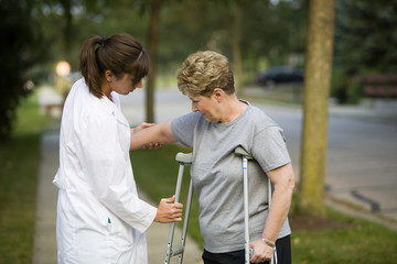 helping a patient with crutches