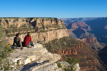 An image of hikers enjoying the view of the Grand Canyon