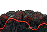Black and red lacy lingerie with coral beads. poster