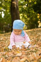Little baby sitting comfort in park.
