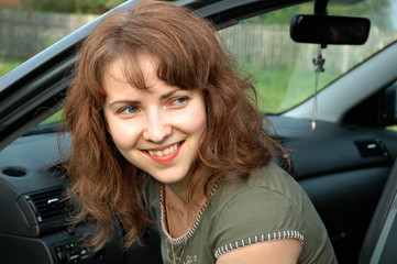 Portrait of the lovely girl in the car