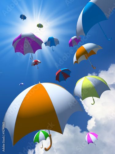 Colorful umbrellas on background of blue sky