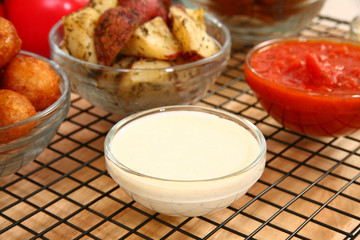Bowl of ranch dressing in kitchen or restaurant.