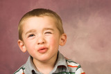 Young boy with short hair and beautiful facial expressions