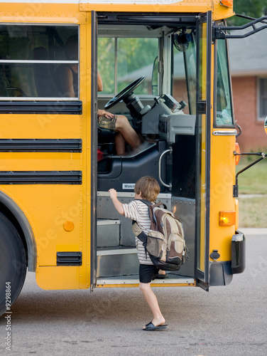 Little Boy Getting on Bus
