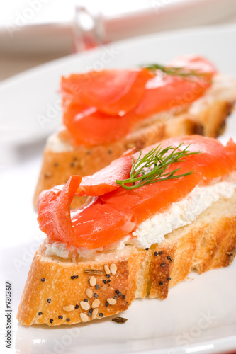 Canape with smoked salmon cream cheese spread and dill by for Canape spread
