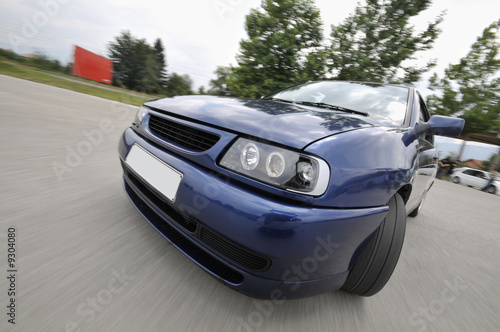 Fast car moving with motion blur