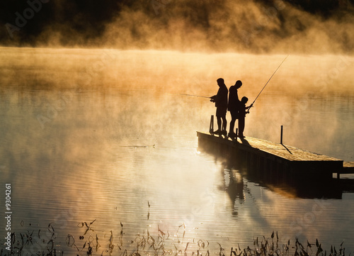 Early morning fishing in autumn on a lake - 9304261