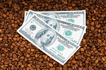 Close up of coffee beans and  dollars