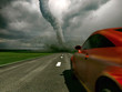 The car rushes on road towards to a tornado (3D)