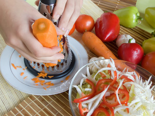 grating of fresh carrot from home kitchen