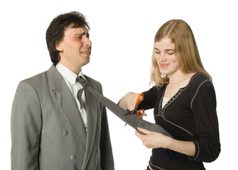 Pretty woman cutting man's necktie with scissors