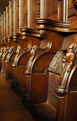 ornate elizabethan carved wooden choir stalls