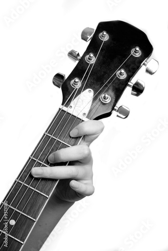 Female hand with classical antique wooden guitar