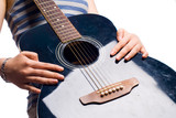 female hands with antique wooden guitar isolated