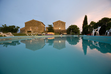 an empty swimming pool at sunset france
