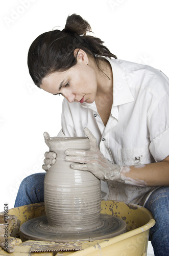Picture of a potter works a potter's wheel