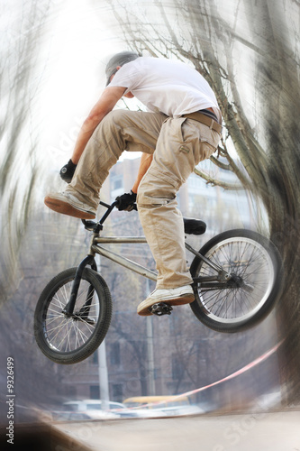 Boy on a bmx/mountain bike jumping. Motion blur photo f/x